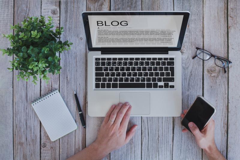 writing a blog, blogger influencer reading text on screen, social media